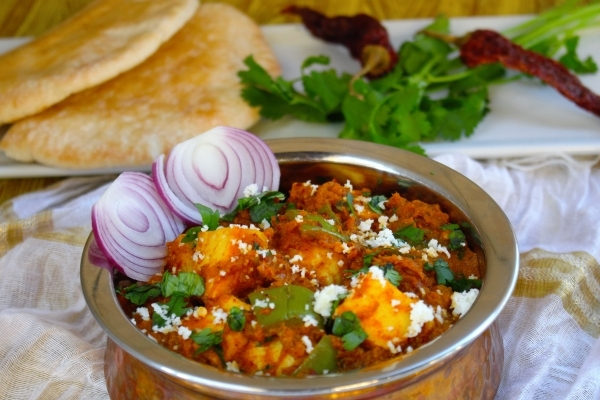 Kadhai Paneer- Cottage Cheese Sauteed in Tomato base with aromatic Indian spices
