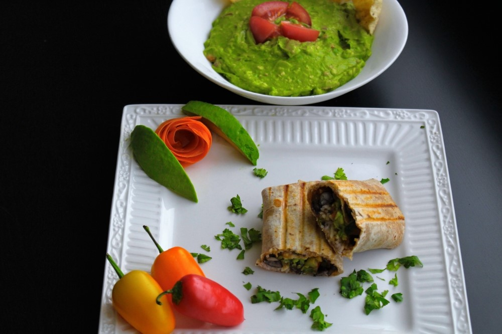 Garden Fresco Burrito Stuffed with roasted vegetables, white rice and black beans